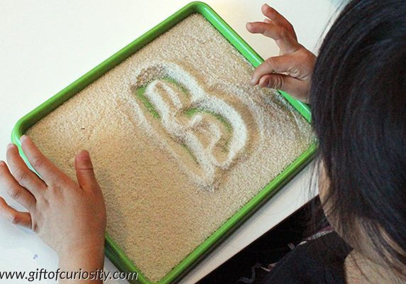 Writing-letters-in-a-salt-tray-4